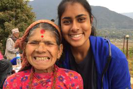 Neha Zahid, left, at a dental health intervention in Nepal.