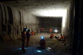Many people standing in excavated cavern in Boulby mine
