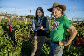 Jennifer Sowerwine and Jon Hoffman in discussion at farm setting.