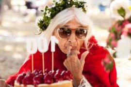 Woman eating cake at her 100th birthday