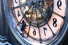image of boy standing on diameter of large clock from Hugo movie