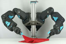 Two robot arms hold a red towel
