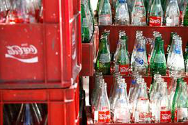 A photo of glass coca cola bottles