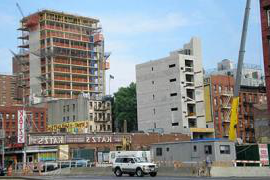 an image of a new building going up next to an old one
