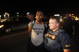 DeRay Mckesson is arrested by a police officer