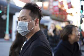Man wearing medical mask in San Francisco's Chinatown.